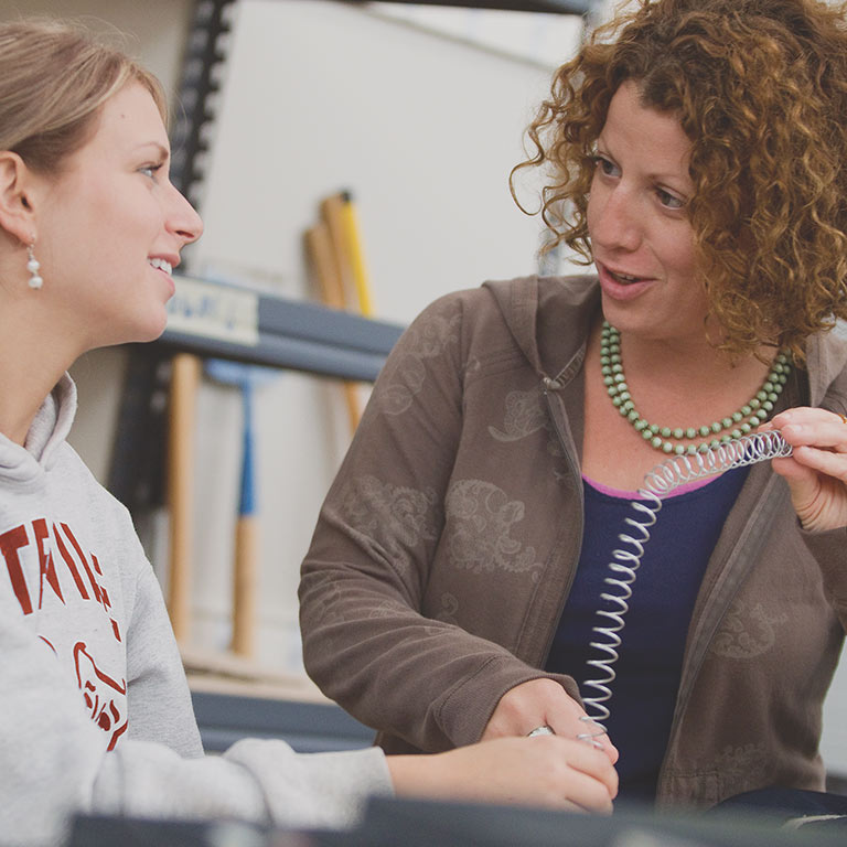 A Herron faculty member talks through a project with her student.