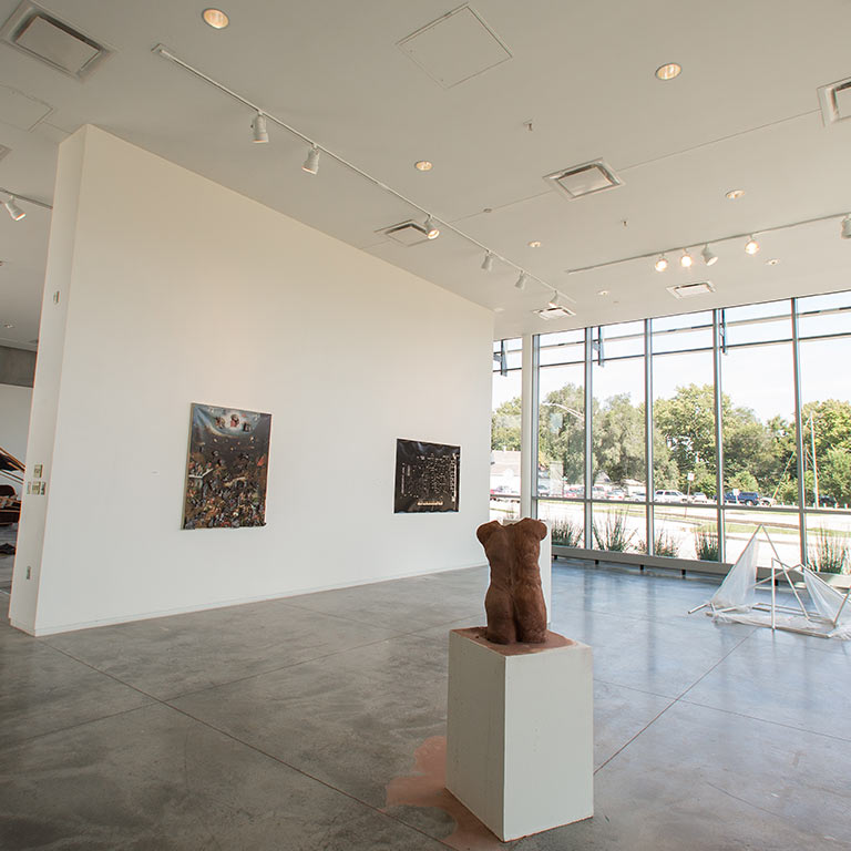 Inside of a large, naturally lit gallery space.