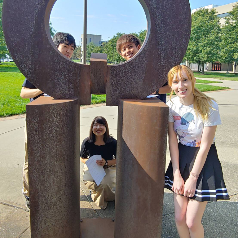 Jennifer Hurley on a scavenger hunt around campus with visiting students from Hakuoh University in Japan.